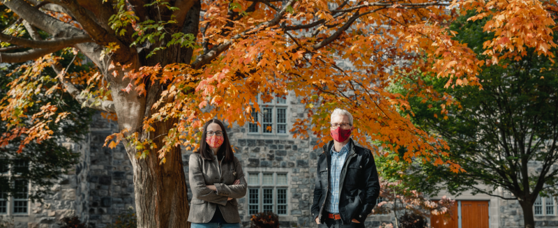 Anne Staples and Jake Socha, faculty members in biomedical engineering and mechanics, standing in front of fall foliage on Virginia Tech campus. Photo by Spencer Roberts of Virginia Tech.